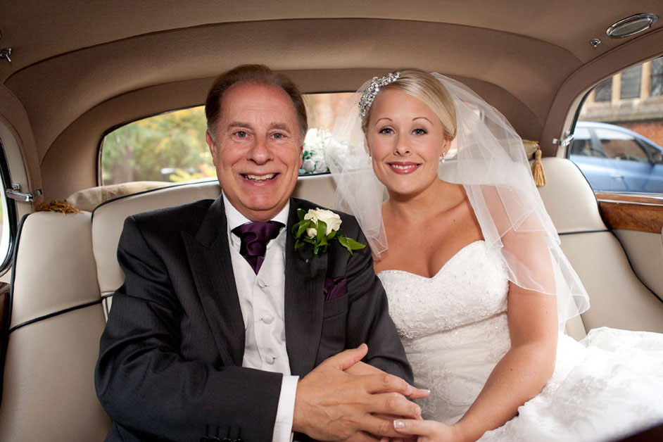bride with father in wedding car essex