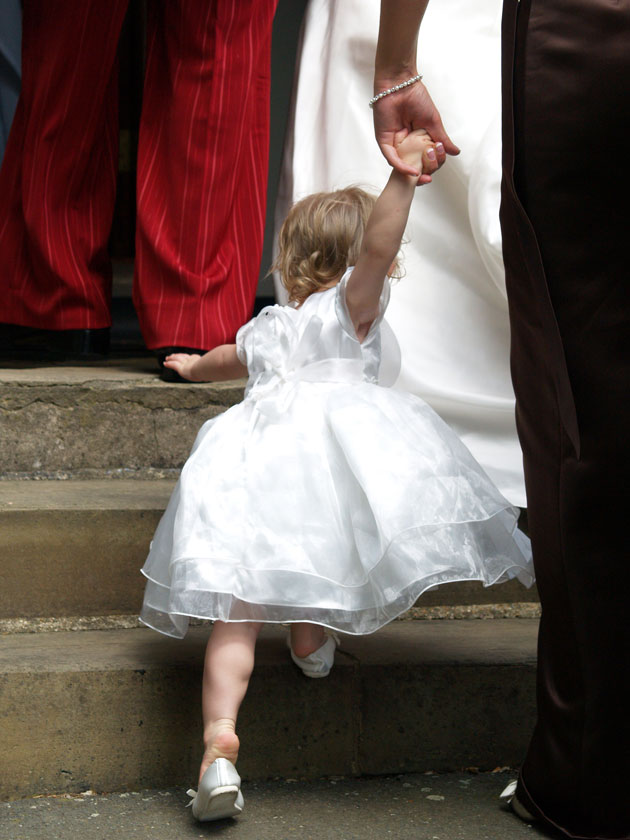 flower girl going up stairs