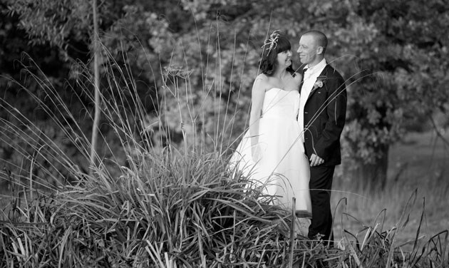 wedding couple photographed from across the pond at Colne Valley Essex