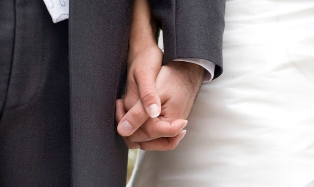 close up of hands of bride and groom