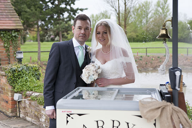 bride and groom with ice cream cart