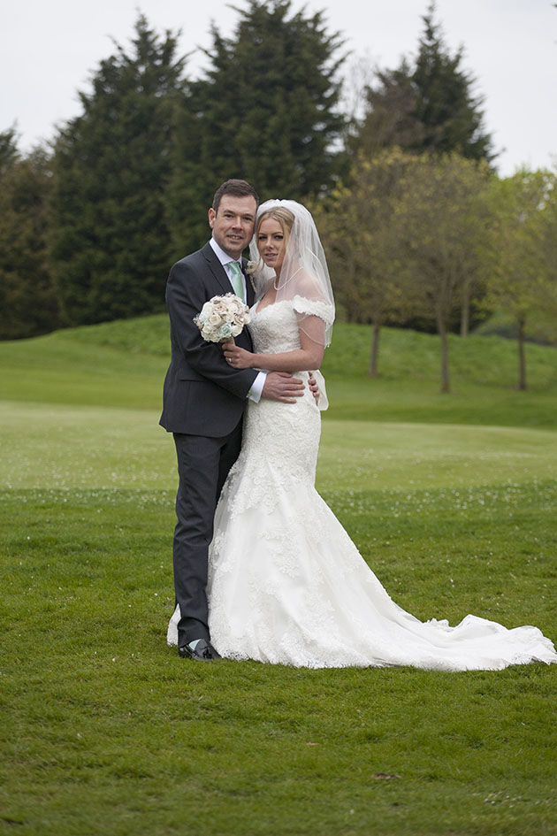 Bride and groom on golf course Essex