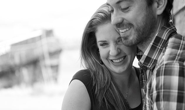 engagement shoot in Essex with woman laughing with her head on man's shoulder