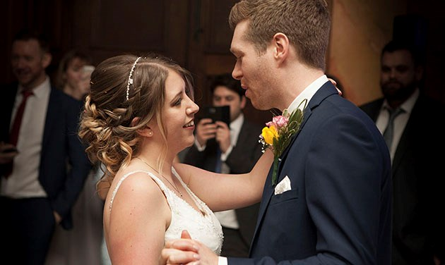 bride and groom facing each other at first dance at Hylands House