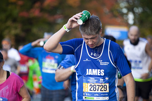 NYC 2016 marathon runner pouring water over head