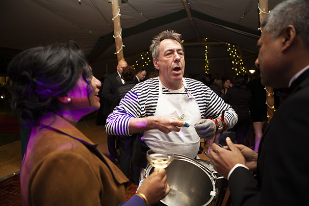 Man serving oysters at a party