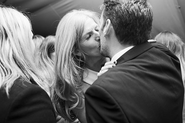 Woman and man kissing at a party