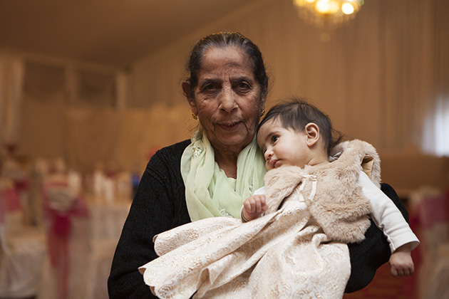 New born held by her Indian great grandmother