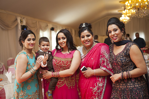 Guests at a party in traditional Indian sari dresses