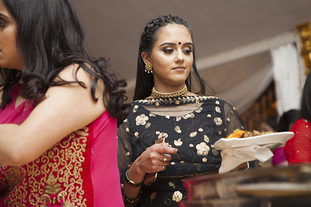 Young girl at an Indian buffet table