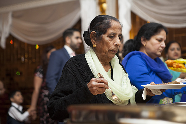 Woman at an Indian buffet table