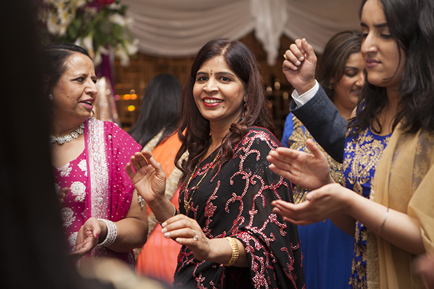 Women dancing at an Indian birthday party