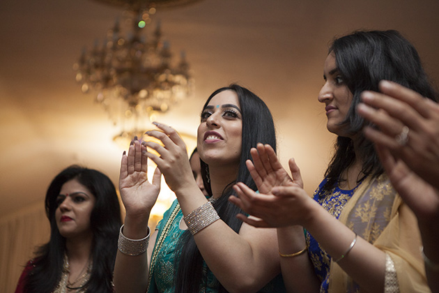 Women clapping hands during the dance at a party