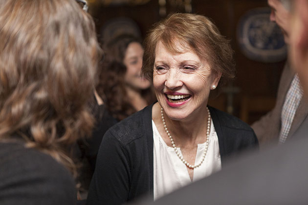 Woman smiling at a party