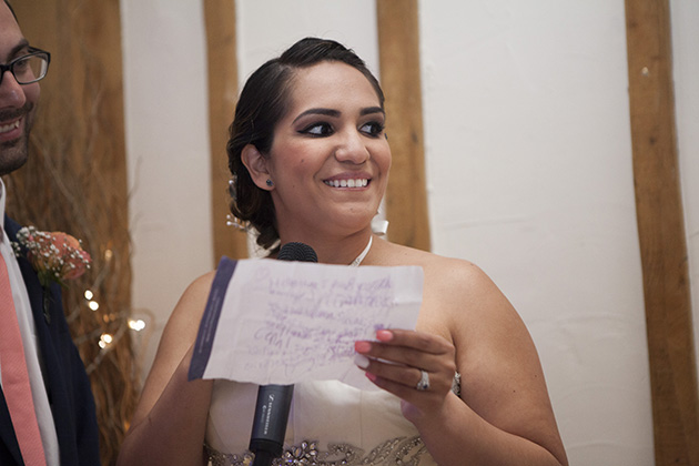 Bride making a wedding speech and holding a written note