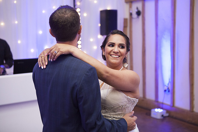 Bride with her arms around groom during their first dance at Vaulty Manor