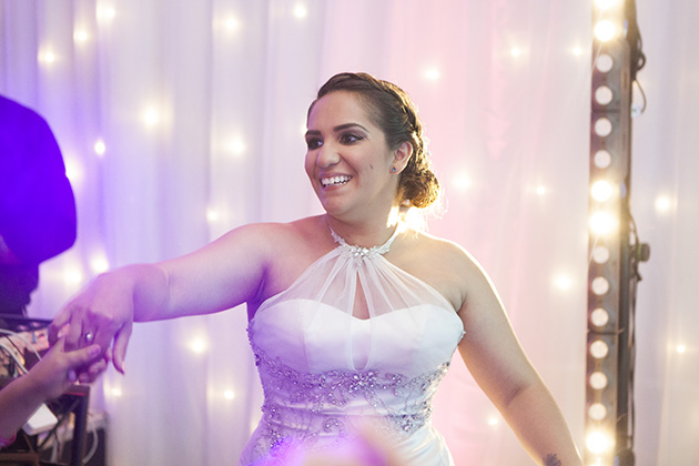 Bride dancing with twinkling lights in the background
