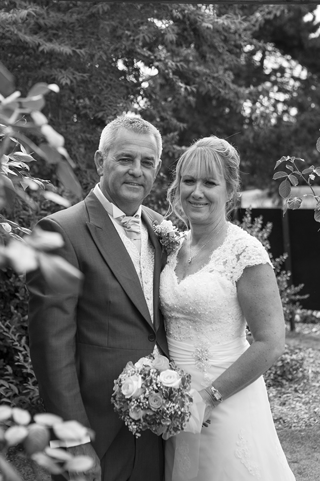Black and white portrait of bride and groom in garden at Little Channels