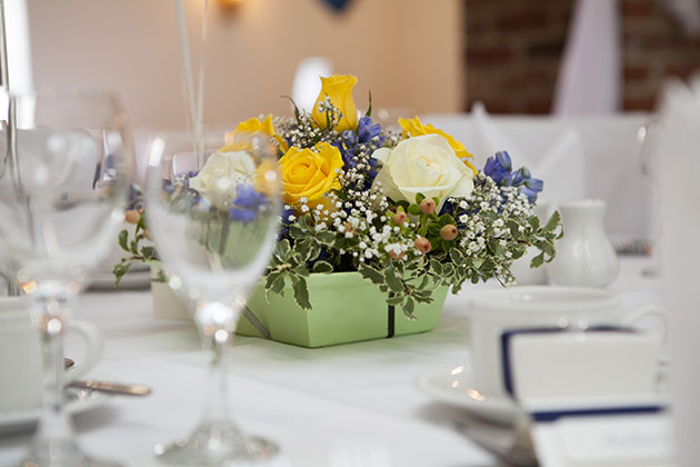wedding table decoration of yellow flowers